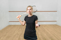 Squash game female player with racket and ball Stock Photo