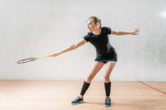 Squash game training, female player with racket Royalty Free Stock Images