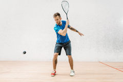Squash game training, male player with racket Royalty Free Stock Images
