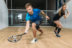 Squash game training, players with rackets Stock Photography