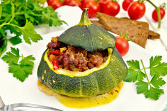 Squash green stuffed on light board Royalty Free Stock Images