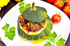 Squash green stuffed with meat on dark board Royalty Free Stock Photos