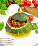 Squash green stuffed with meat on light board Royalty Free Stock Image