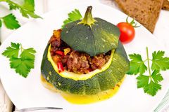 Squash green stuffed in plate on light board Royalty Free Stock Image