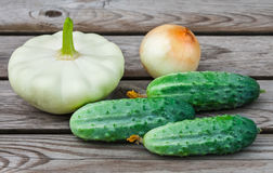 Squash, onions and cucumbers on table Stock Photography