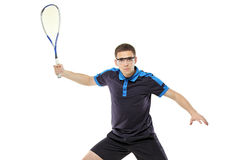 Squash player posing against white background Stock Photo