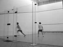 Squash players in court. A pair of squash players were competing and I took their picture from behind the glass partition Stock Images