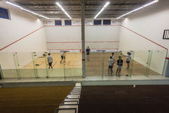 Squash Players Game Two Courts. Squash courts with school teenagers playing and practicing at Westville Country club two courts Royalty Free Stock Photo