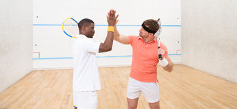 Squash players give highfive Stock Photo