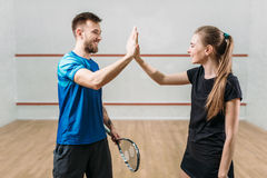 Squash players with rackets after match Stock Image