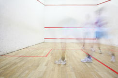Squash playing. Two squash players in motion blur playing Royalty Free Stock Photos