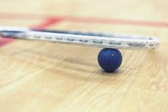 Squash racket and ball Royalty Free Stock Photo