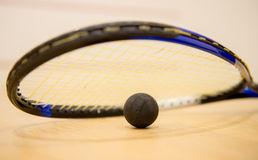 Squash racket with ball Royalty Free Stock Photo