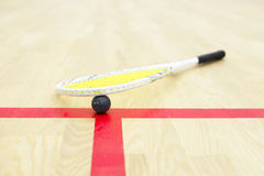 Squash racket and ball on the court Royalty Free Stock Images
