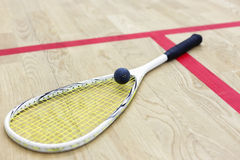 Squash racket and ball on the court Royalty Free Stock Photography