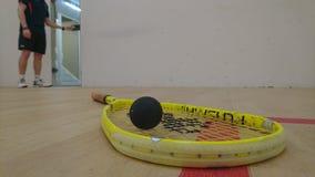 Squash racket on court floor Stock Image