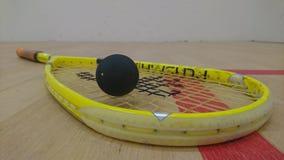 Squash racket on court floor Royalty Free Stock Image