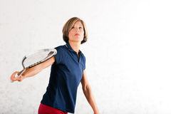 Squash racket sport in gym. Mature woman playing squash as racket sport in gym, it might be a competition Stock Photos