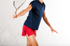 Squash racket sport in gym, woman playing. Mature woman playing squash as racket sport in gym, it might be a competition Royalty Free Stock Photos