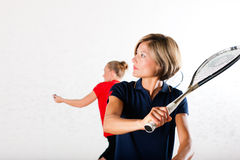 Squash racket sport in gym, women competition Royalty Free Stock Photo