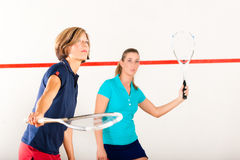 Squash racket sport in gym, women competition. Two women playing squash as racket sport in gym, it might be a competition Royalty Free Stock Photo