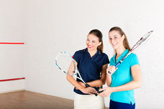 Squash racket sport in gym, women training Stock Photography