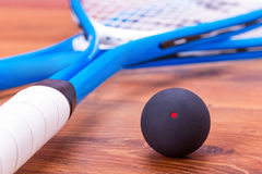 Squash rackets and ball. Close up of a squash rackets and ball Stock Image