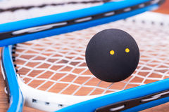 Squash rackets and ball Royalty Free Stock Photos