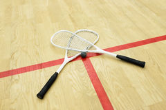 Squash rackets and ball. On the court near red line. Racquetball equipment. Photo with selective focus royalty free stock images