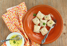 Squash ravioli with butter sauce. Served on a plate Stock Images