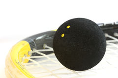 Squash rocket with ball detail. Squash rocket with two-yeallow dotted black ball stock image