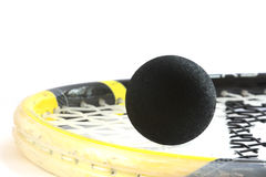 Squash rocket with ball detail. Squash rocket with two-yeallow dotted black ball royalty free stock photos