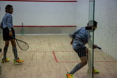 Squash Room with player in competition stock photos