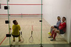 Squash Room with training player royalty free stock photo