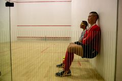 Squash Room with training player royalty free stock image