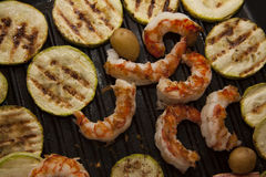 Squash and shrimps on pan Stock Photos