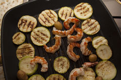 Squash and shrimps on pan Royalty Free Stock Photo