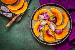 Squash Slices with Red Onions to Roast. Butternut Squash Slices with Red Onions and Thyme Prepared for Roasting, copy space for your text royalty free stock image