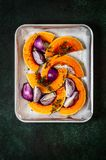 Squash Slices with Red Onions to Roast. Butternut Squash Slices with Red Onions and Thyme Prepared for Roasting, copy space for your text stock photos