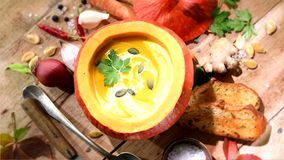 Squash soup served in a pumpki stock video