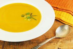 Squash Soup in White Bowl Stock Images