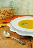 Squash Soup in White Bowl with Bread Royalty Free Stock Image