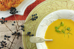 Squash Soup in White Bowl with Bread Royalty Free Stock Photos
