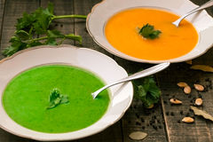 Squash and spinach soup. Squash and spinach cream soups full of minerals and vitamins Stock Image