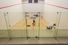 Squash Teenagers Court Game. Squash court with school boys teenagers playing game at Westville Club Royalty Free Stock Image