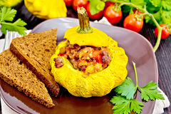 Squash yellow stuffed with meat and vegetables on board Royalty Free Stock Photography