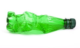 Squashed plastic green bottle Royalty Free Stock Photos