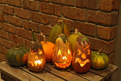 Squashes and carved eggplants at halloween Royalty Free Stock Photos