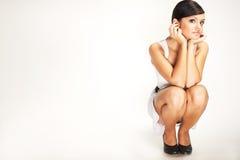 Squat brunette Stock Photography