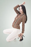 Squat pose by sexy Asian beauty Stock Photos